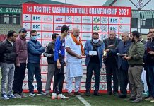 Divisional Commissioner PK Pole presenting cash reward to players and officials at TRC Ground Srinagar on Tuesday.