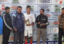 A player being awarded with a trophy by dignitaries at Srinagar.