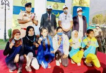 Winners posing for a group photograph with dignitaries during the Jashn-e-Dal festival at Srinagar on Saturday.