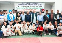 Winners posing a group photograph with dignitaries at Poonch on Friday.