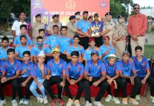 Chief guest and other dignitaries presenting trophy to a winning team at KC Club Jammu on Monday.