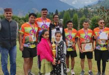 Participants posing for a group photograph along with trophy at Bhaderwah. —Excelsior/Tilak Raj
