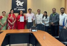 Chairperson FICCI FLO JKL and Director IIT-Jammu displaying copies of MoU signed between two institutions.