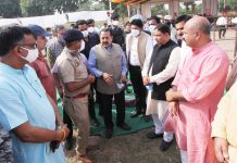 Union Minister, Dr Jitendra Singh reviewing arrangements with officers at Bhagwati Nagar rally ground on Friday. — Excelsior/Rakesh