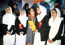 Union MoS Meenakshi Lekhi posing with NEET qualifiers at Baramulla on Tuesday.