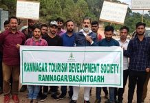Locals protesting against slow pace of work on Ramnagar-Basantgarh road.