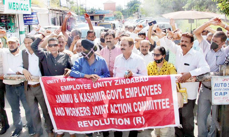 Govt employees staging protest demonstration in support of their demands near Press Club in Jammu on Wednesday. -Excelsior/ Rakesh