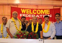 Newly re-elected president of Federation of Retailers Associations, Yash Paul Gupta being felicitated by JCCI president Arun Gupta and others after his election in Jammu on Sunday. -Excelsior/Rakesh