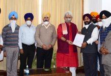 Sikh delegation submitting memorandum to Lt. Governor at Srinagar.