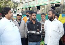 Cong leader, Raman Bhalla interacting with workers leaving Kashmir, at Jammu Railway Station on Monday.