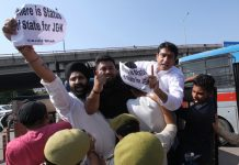 Policemen trying to arrest Youth Cong activists during protest in Jammu on Tuesday. -Excelsior/Rakesh
