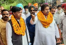 Senior Cong leader Raman Bhalla interacting with people in Digiana area on Sunday.