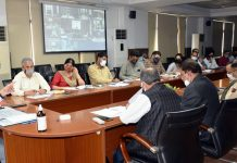Div Com chairing a meeting on Wednesday.