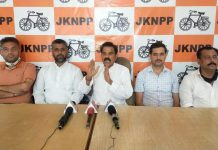 NPP chairman Harsh Dev Singh addressing press conference in Jammu on Sunday.