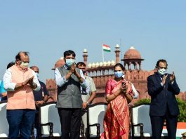 Union Health Minister Mansukh Mandaviya stands near the world's largest khadi Tricolor in the premises of the historic Red Fort in New Delhi.