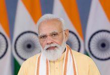 Prime Minister Narendra Modi addressing at the Bhoomi Poojan ceremony of Hostel Phase-1 built by Saurashtra Patel Seva Samaj in Surat, through video conferencing, in New Delhi on Friday. (UNI)