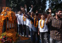 JJSF activists raising slogans at Shaheedi Sthal outside GGM Science College in Jammu on Saturday. —Excelsior/Rakesh