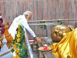 Prime Minister Narendra Modi offering prayer at Mahaparinirvana Temple on the occasion of Abhidhamma Day, in Kushinagar on Wednesday. (UNI)