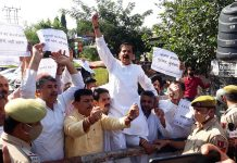 JKNPP leaders during a protest at Jammu on Tuesday.