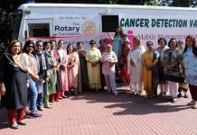 Office bearers of Rotary Club Jammu Elite along with doctors posing for a group photograph during cancer detection camp at Jammu.